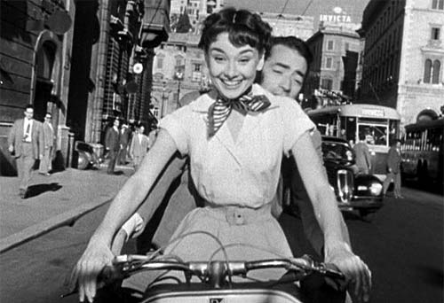 Audrey Hepburn and Gregory Peck explore the Eternal City on a Vespa in Roman Holiday.